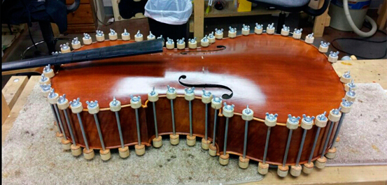 Once we completed internal repairs, we replaced the top of the cello.